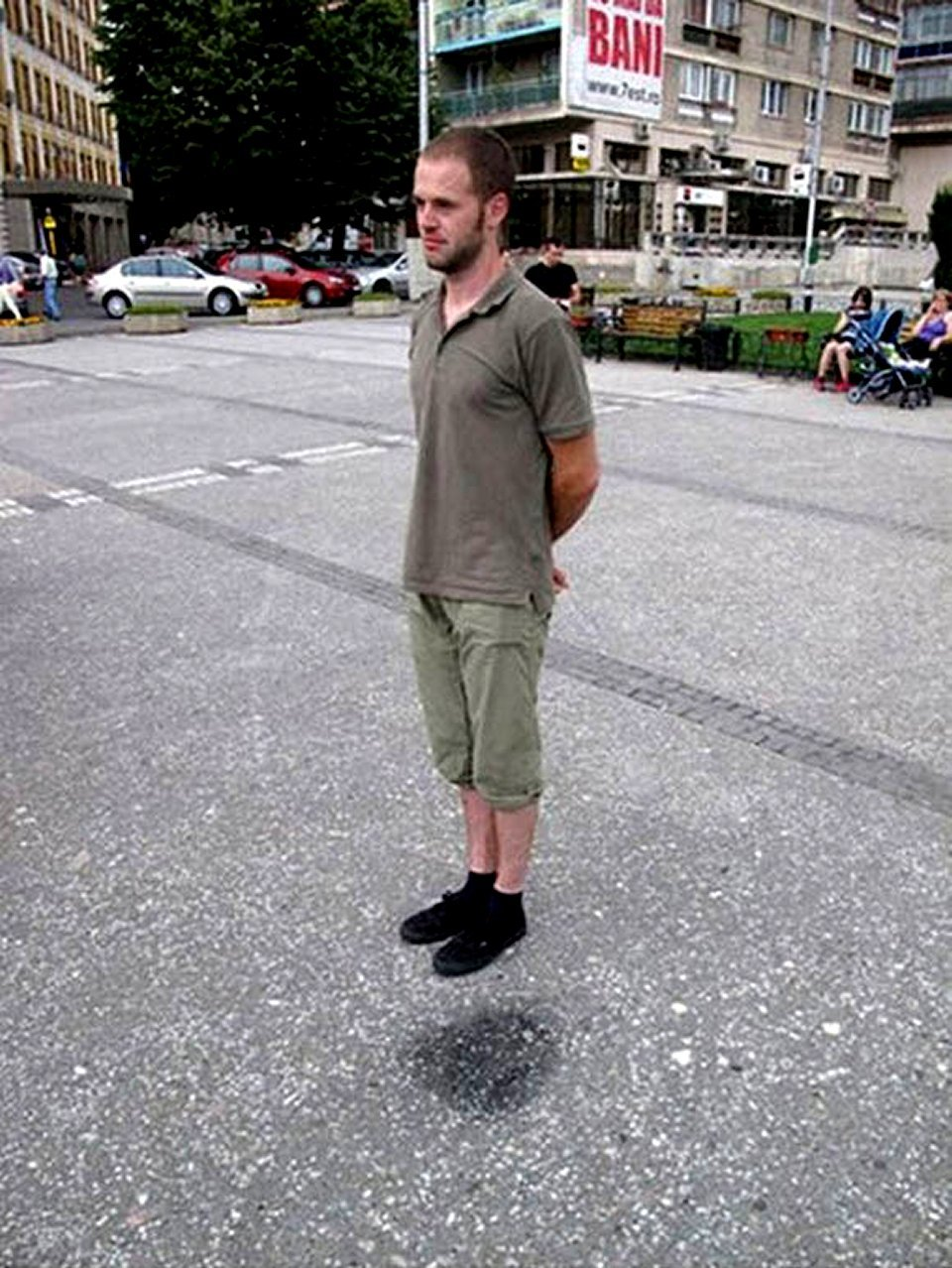 actual non photoshopped picture of levitating man on public street